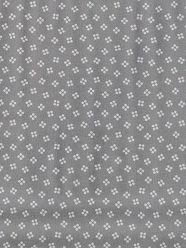 Tela agujeros sobre gris de la colección Coser y Tejer by Carme Salas de BCN Fabrics