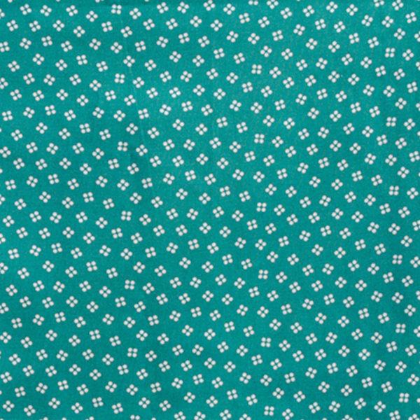 Tela agujeros sobre verde de la colección Coser y Tejer by Carme Salas de BCN Fabrics