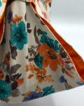 Bolsa portatartas de loneta con motivos florales y algodon naranja, hecha a mano por CraftyLu